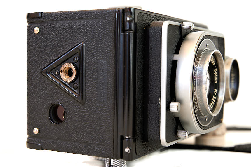 The red glass viewing window on the underside of the camera