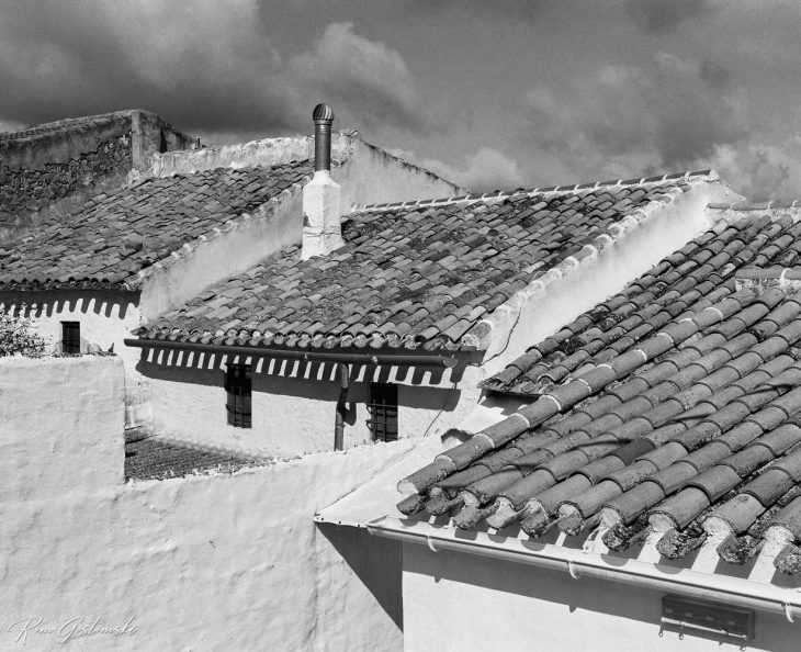 Rooftops of white village houses.